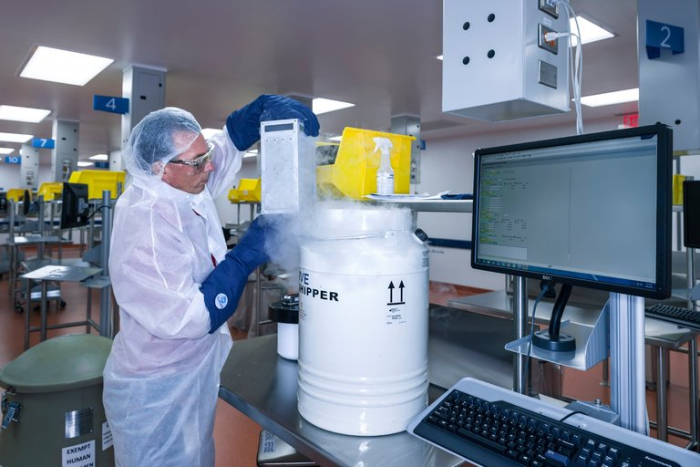 A technician working with human cells.